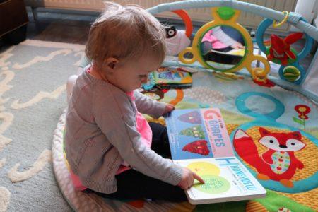 Shiloh reading Mrs. Peanuckle's Fruit Alphabet