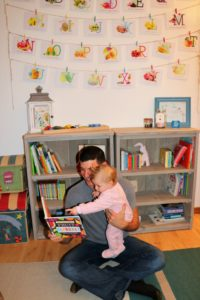 Shiloh and Daddy reading Mrs. Peanuckle's Fruit Alphabet Book