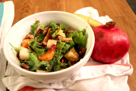 Kale, Pear and Pomegranate Harvest Salad with Pomegranate Seeds