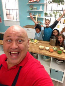 Chef Gino teaching kids about ingredients and how to cook them